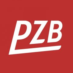 Białe litery PZB na czerwonym tle